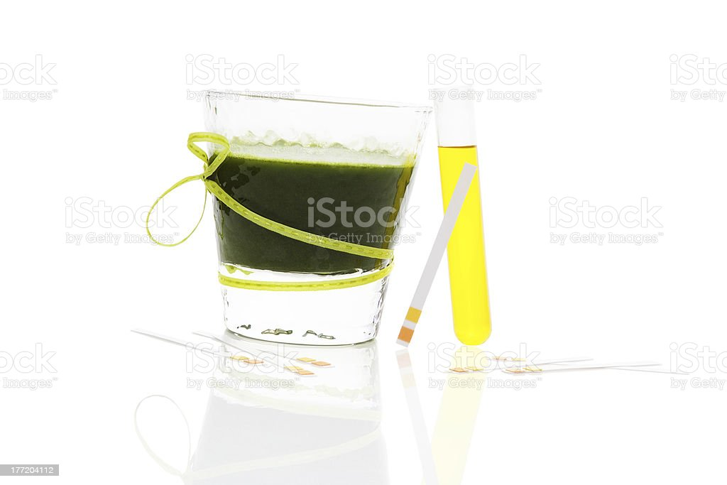 Green drink, litmus paper and urine in test tube. royalty-free stock photo