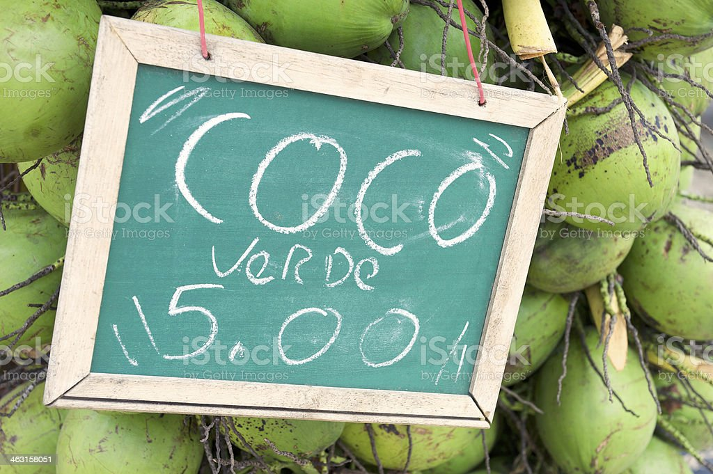 Green Drinking Coconuts for Sale Sign in Brazil stock photo
