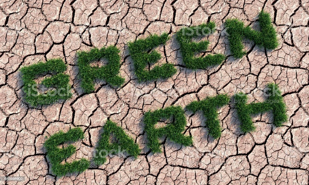 Green Earth Text On Cracked Land stock photo