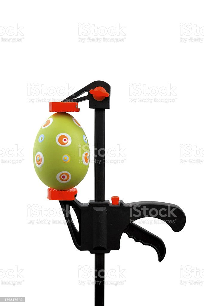 Green Easter egg and vise grip stock photo