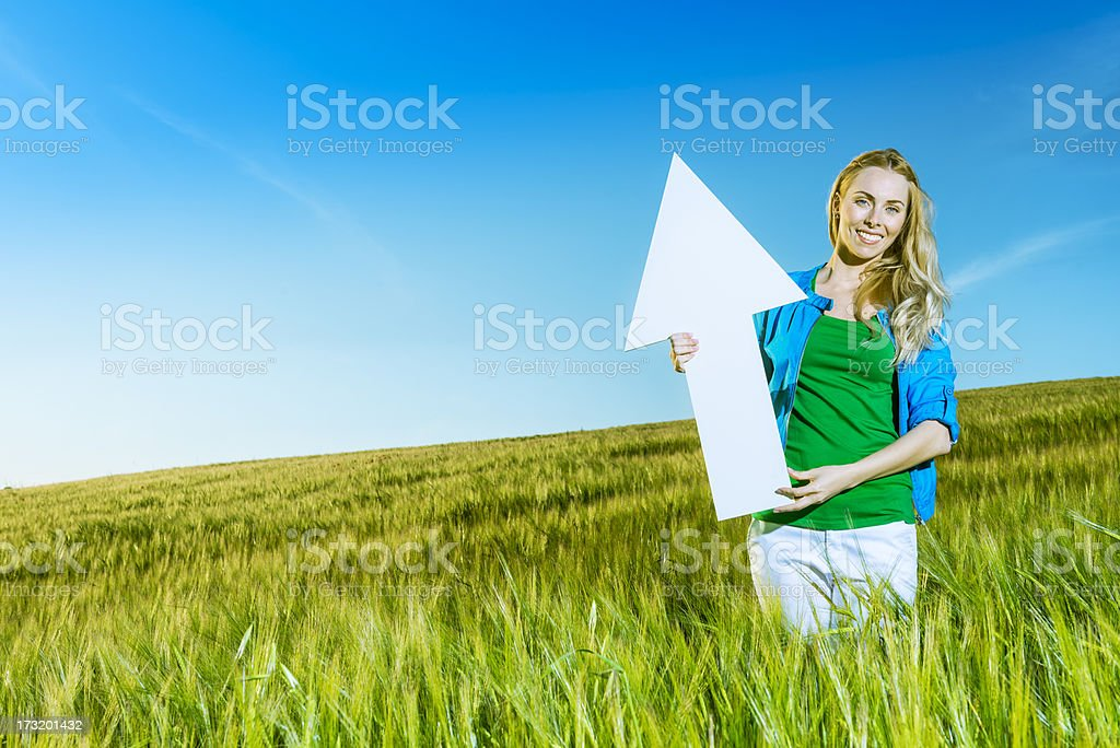 Green ecology: girl pointing up royalty-free stock photo