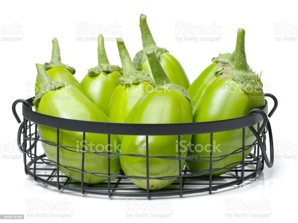 Green eggplants on white background stock photo