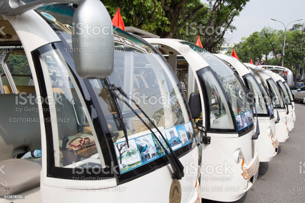 Green electric car vehicles parking in range while waiting for passenger stock photo