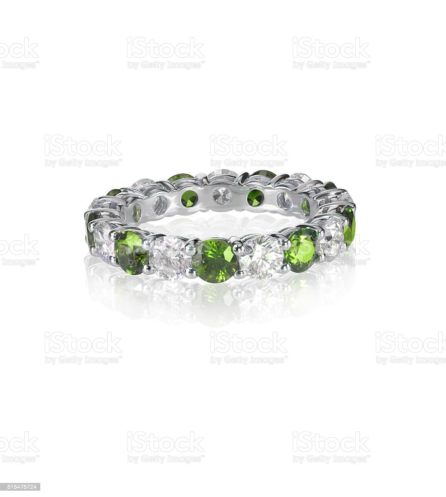 green emerald and diamond wedding band ring stock photo