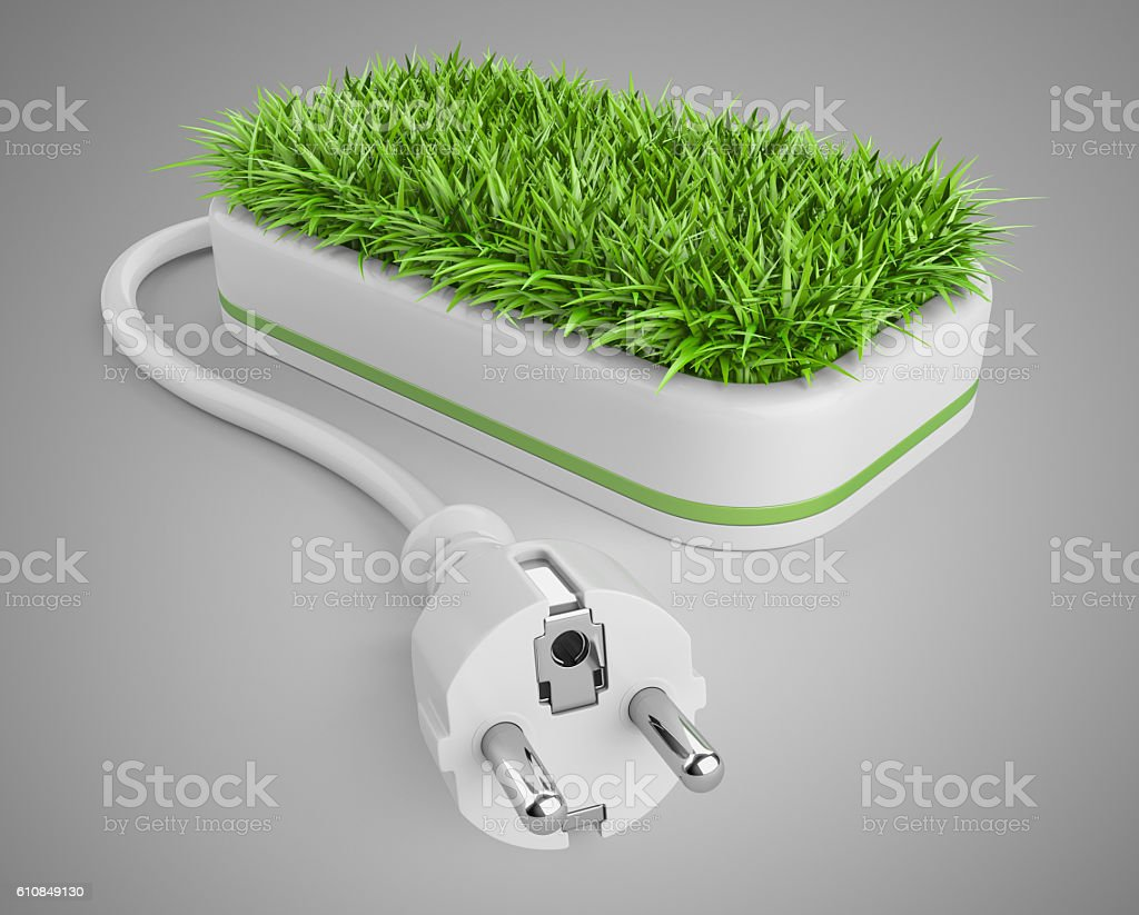 Green energy concept with plug and pot with grass. stock photo