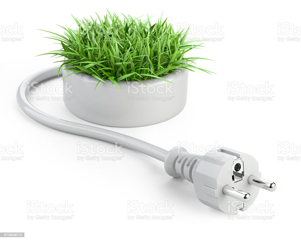Green energy concept with plug and round pot with grass. stock photo