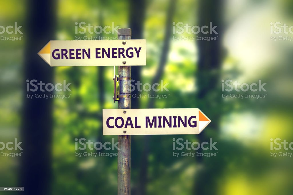 Green energy or coal mining stock photo