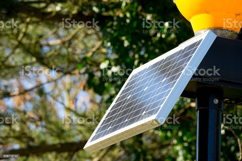 Green energy, Photovoltaic Solar Cell with hand stock photo