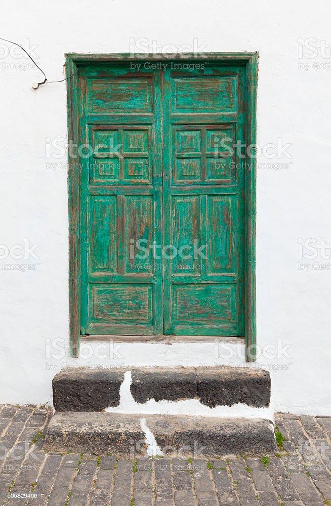 Green entry door stock photo