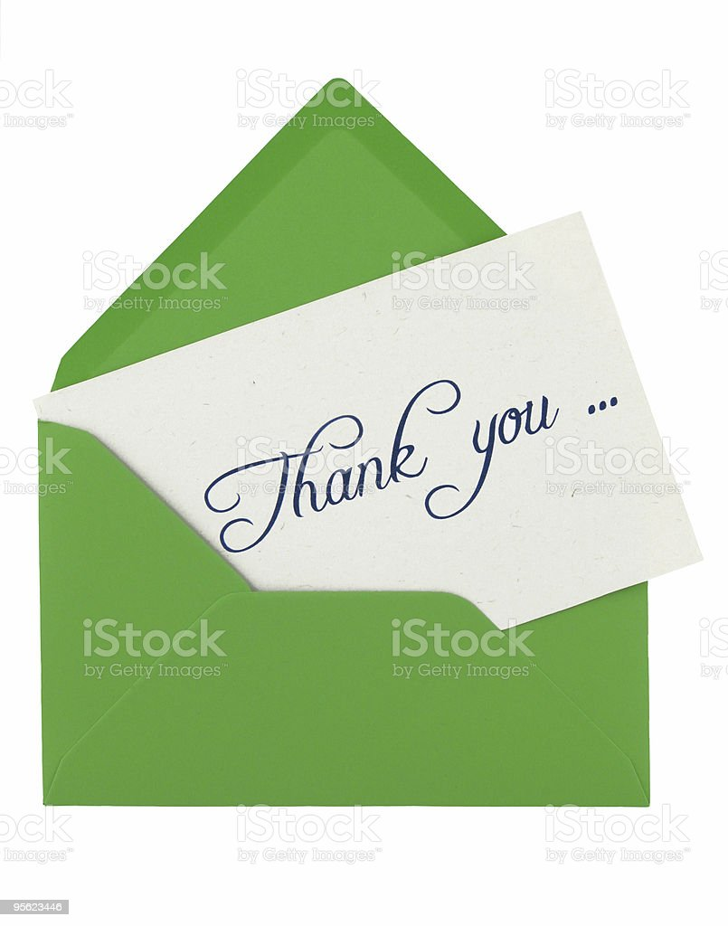 Green envelope with a thank you note inside on white stock photo