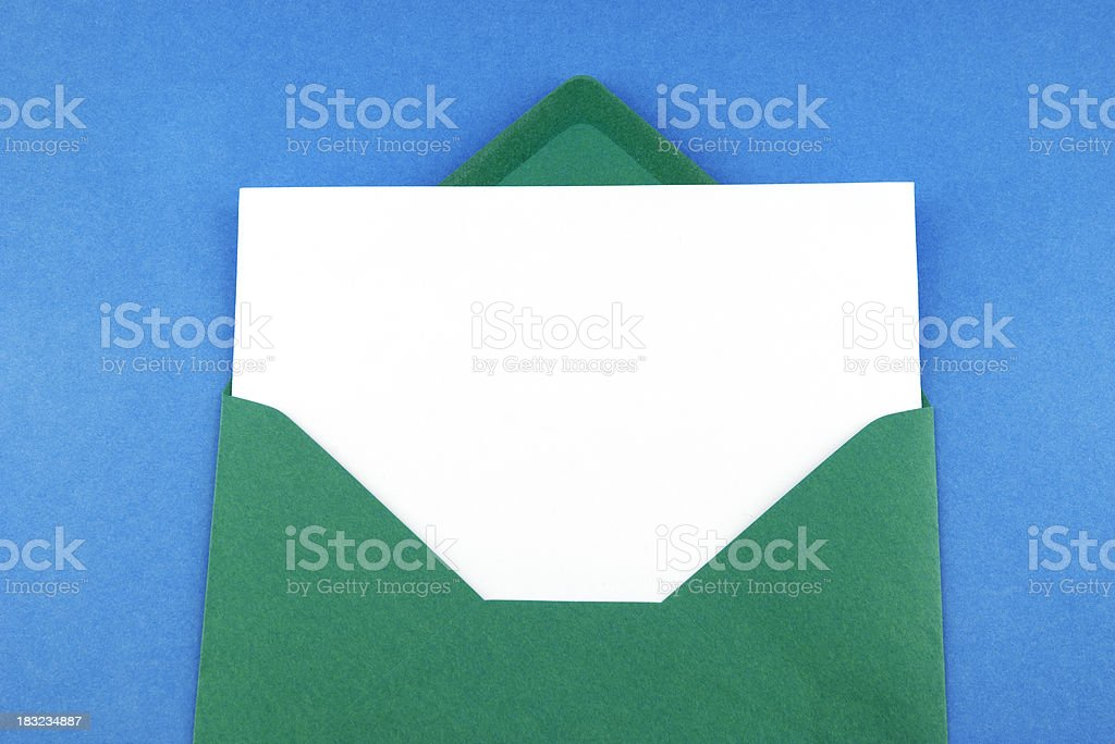 Green envelope with blank greeting card royalty-free stock photo