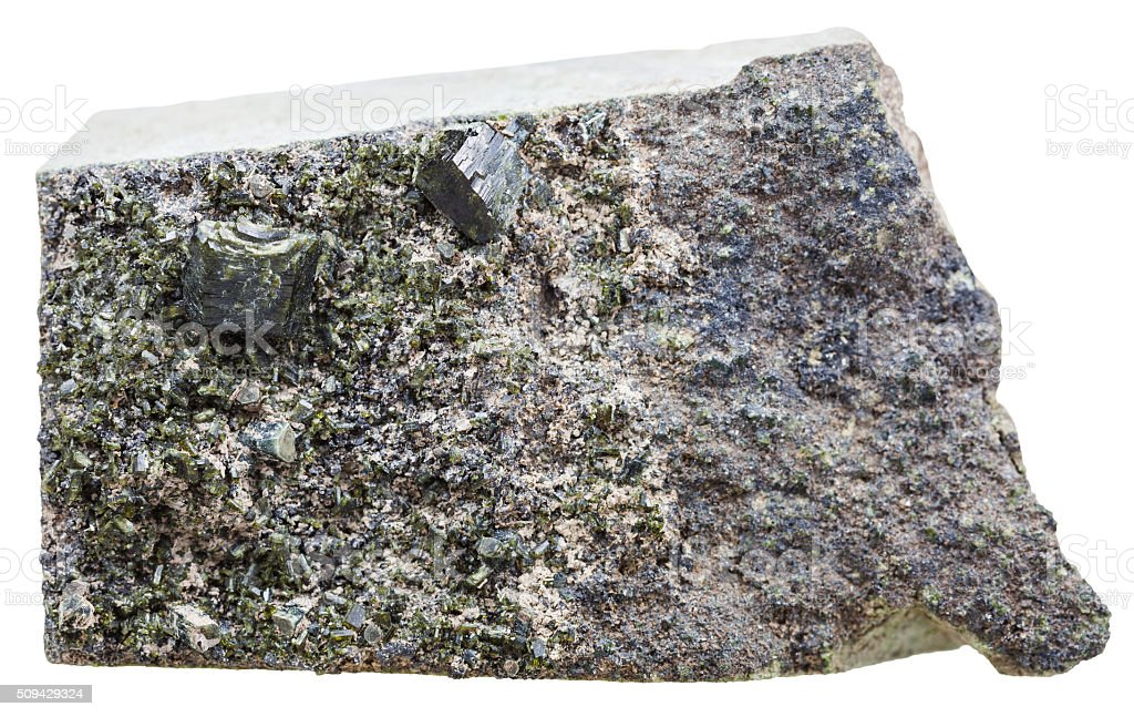green epidote crystals on rock isolated stock photo