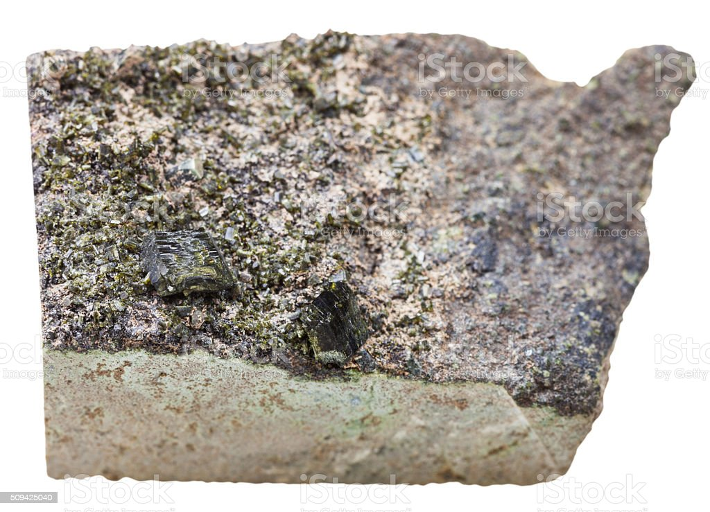 green epidote crystals on stone isolated on white stock photo