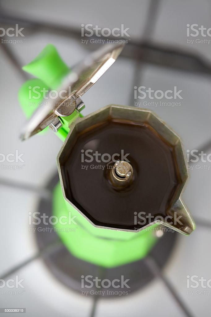 Green Espresso Maker on Top Of Stove with Lid Open stock photo