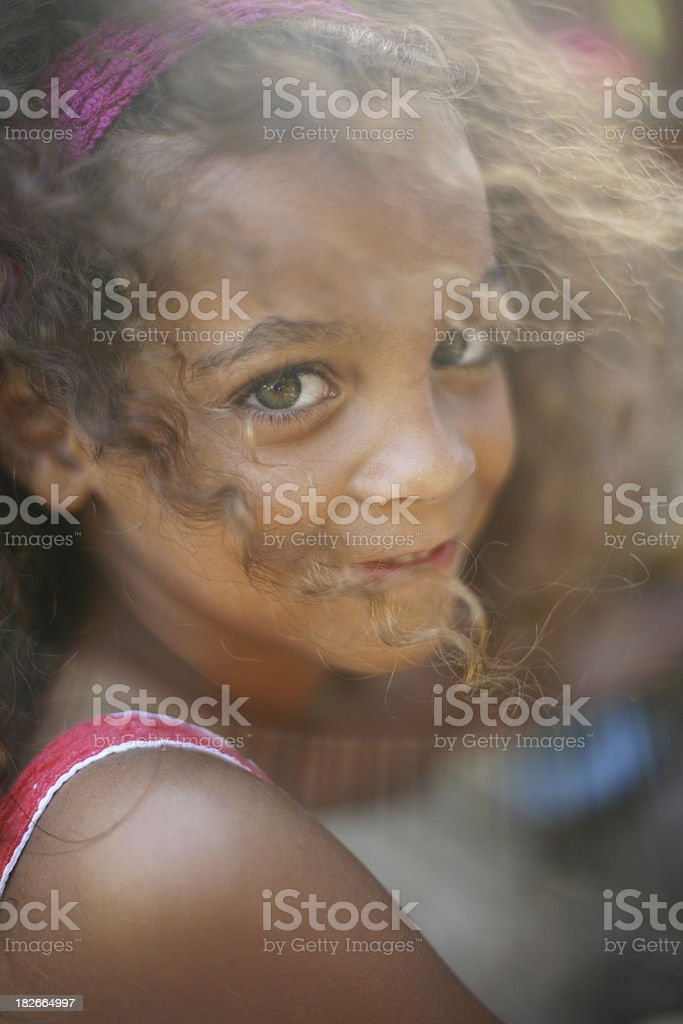 green eyed girl with soft smile, a portrait royalty-free stock photo