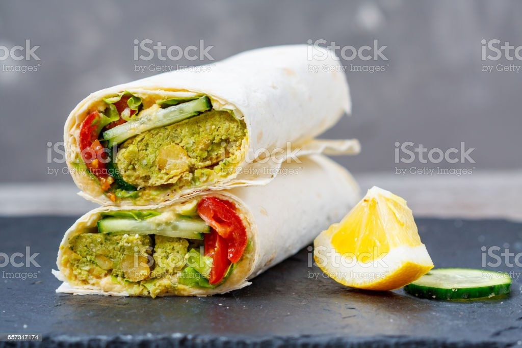 Green falafel with hummus and vegetables stock photo
