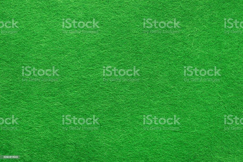 Green felt background stock photo