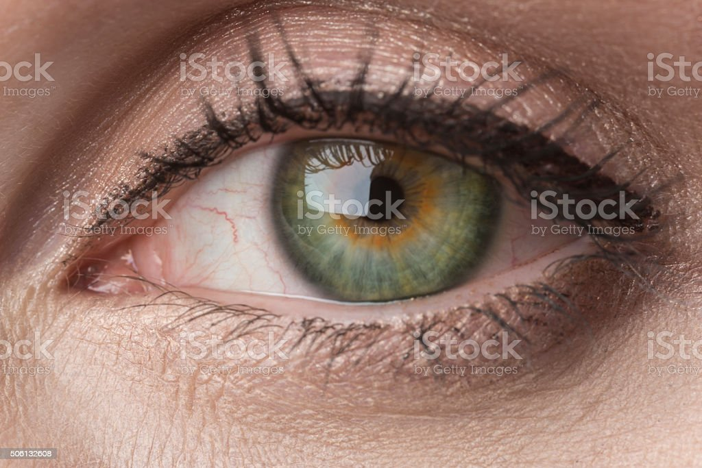 green female eye stock photo