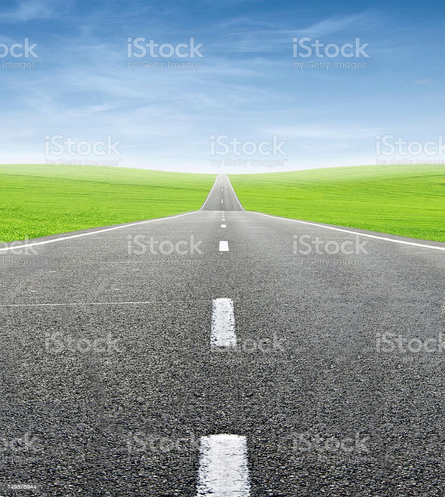 green field and road over blue sky royalty-free stock photo