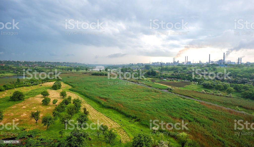 green field near the factory mital steel Galati stock photo