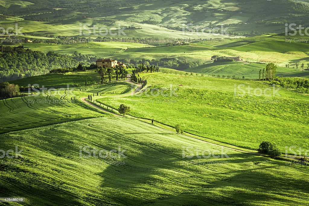 Green fields and meadows with agrotourism in Italy royalty-free stock photo