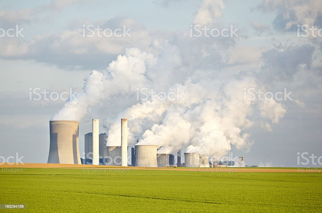 Green Fields In Front Of Industry Skyline royalty-free stock photo