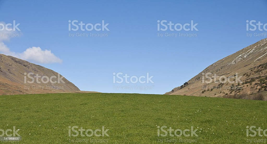 Green fields in the Mountains stock photo