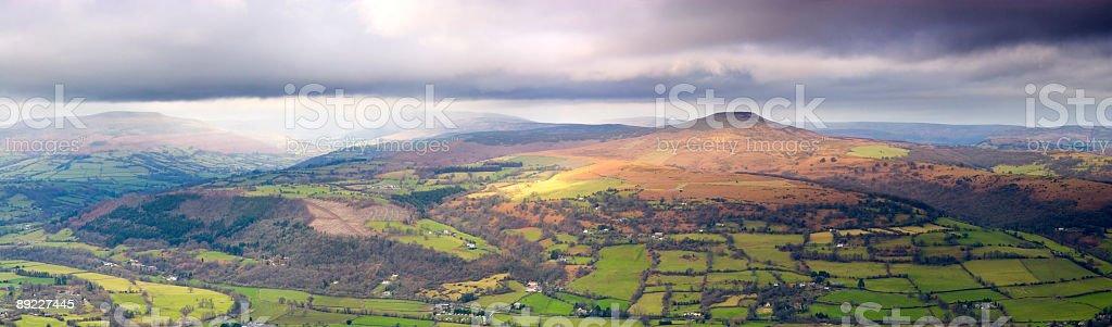 Green fields, mountain horizon stock photo