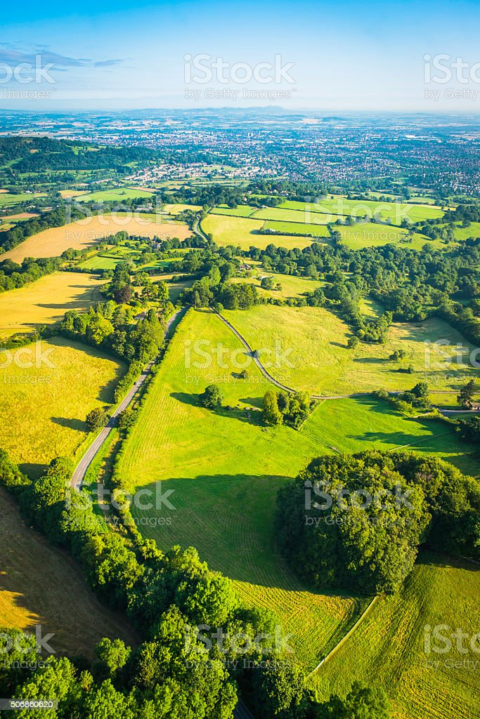 Green fields patchwork pasture rural road country town aerial photo stock photo