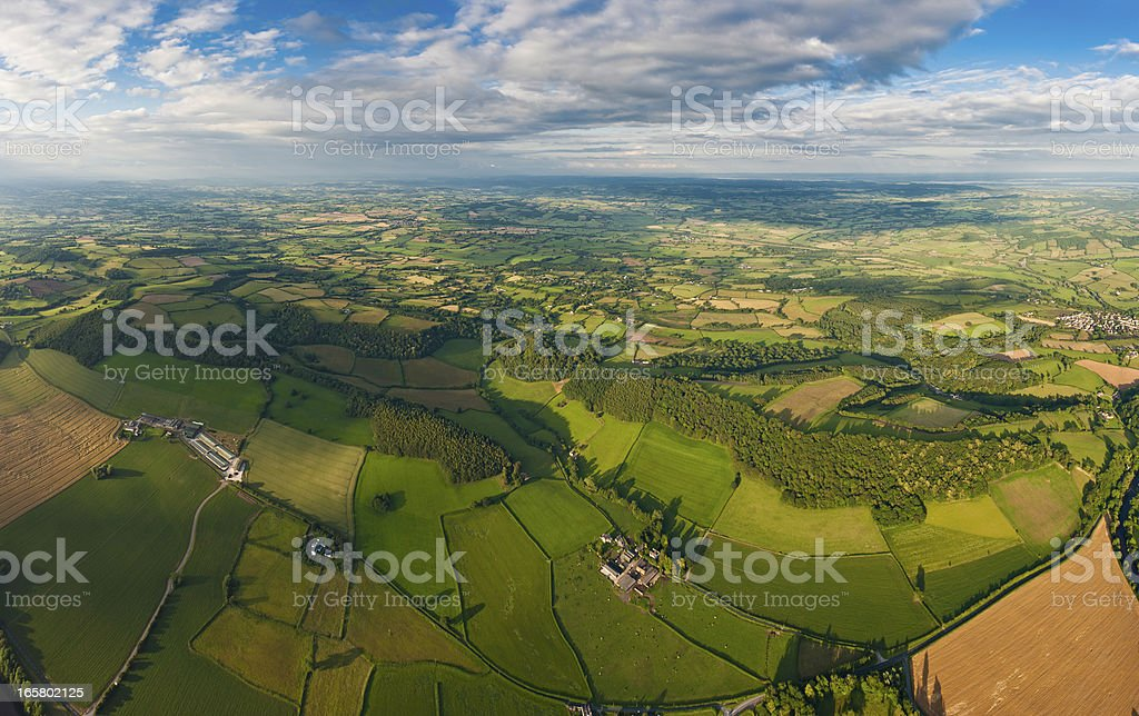 Green fields vibrant patchwork landscape aerial panorama royalty-free stock photo