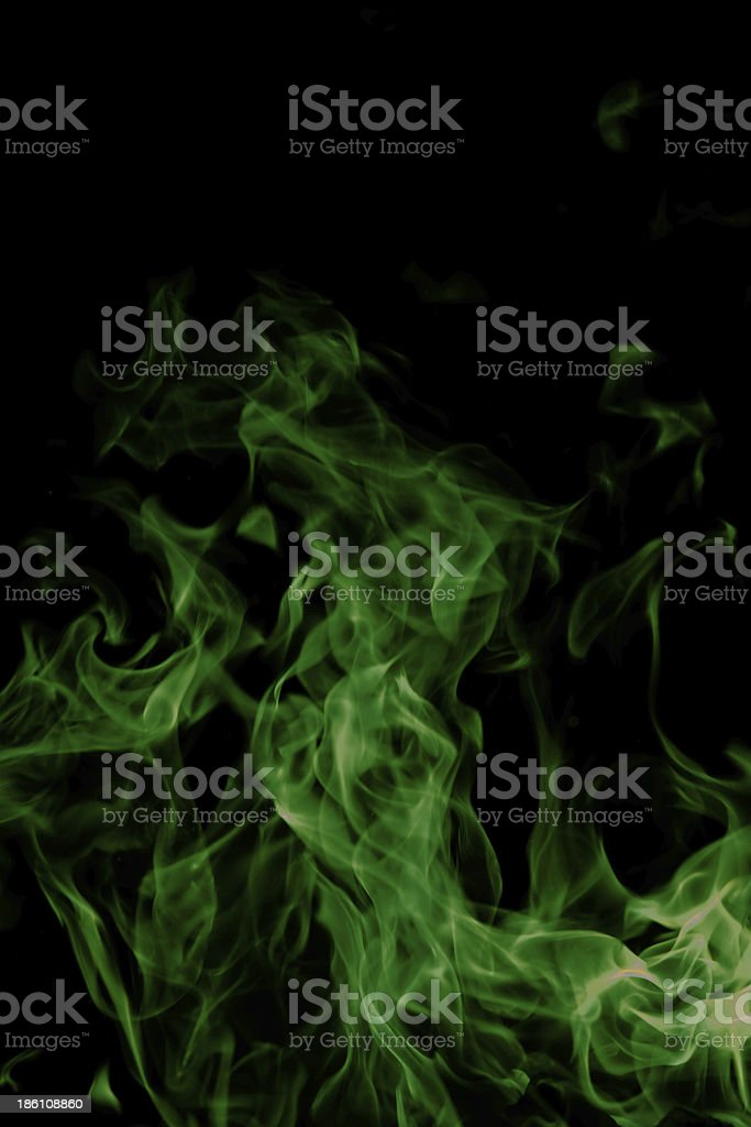green fire on black background royalty-free stock photo