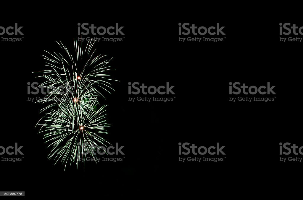 Green fireworks with copy space stock photo