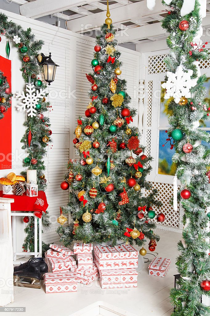 Green fir-tree with red and gold Christmas toys stock photo