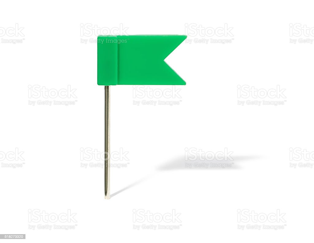 Green flag pin with shadow stock photo
