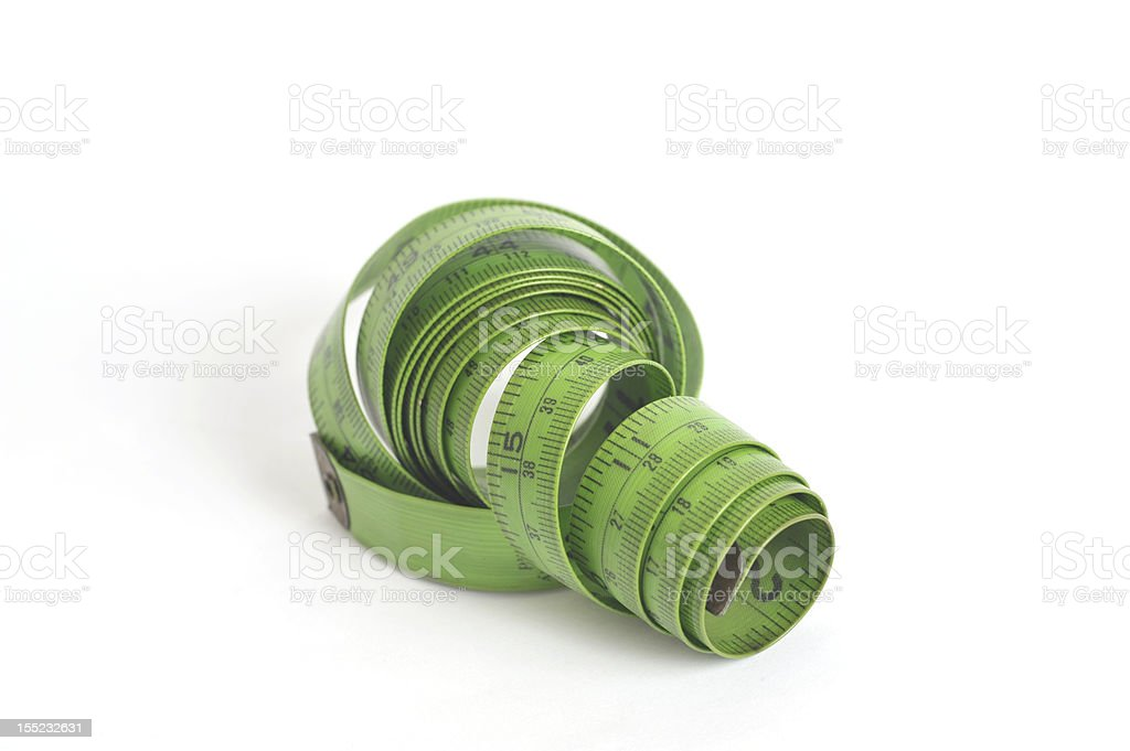Green flexible tape measure royalty-free stock photo
