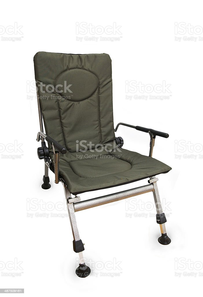 Green folding camp chair isolated on white background stock photo