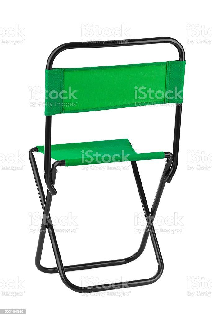 Green folding chair stock photo