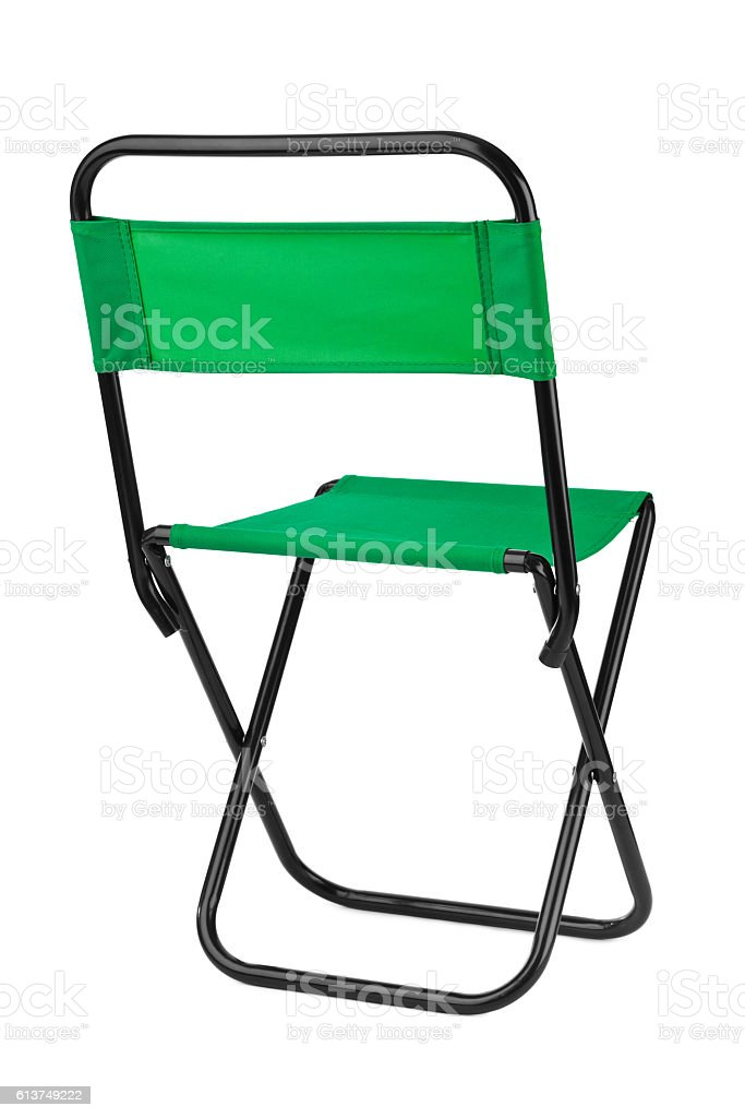 Green folding chair stock photo
