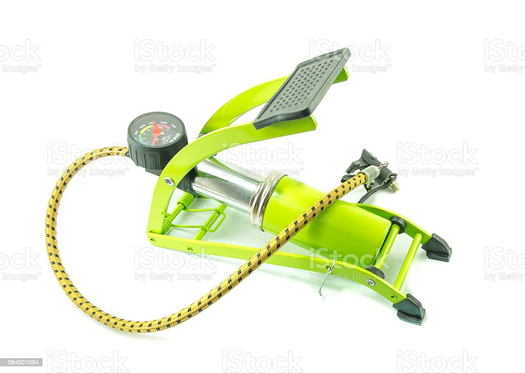 Green foot air pump on white background stock photo