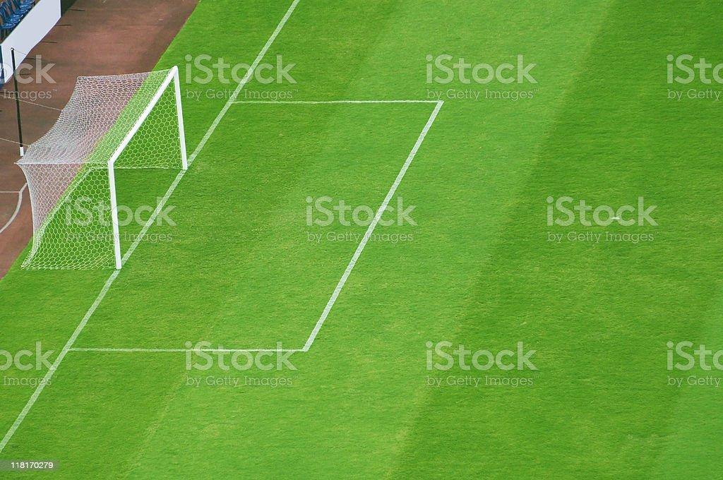 Green football field in the stadium royalty-free stock photo