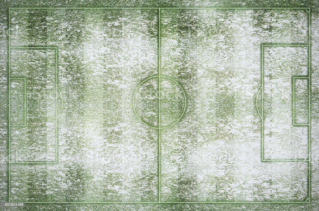 Green football stadium and field in winter snow stock photo