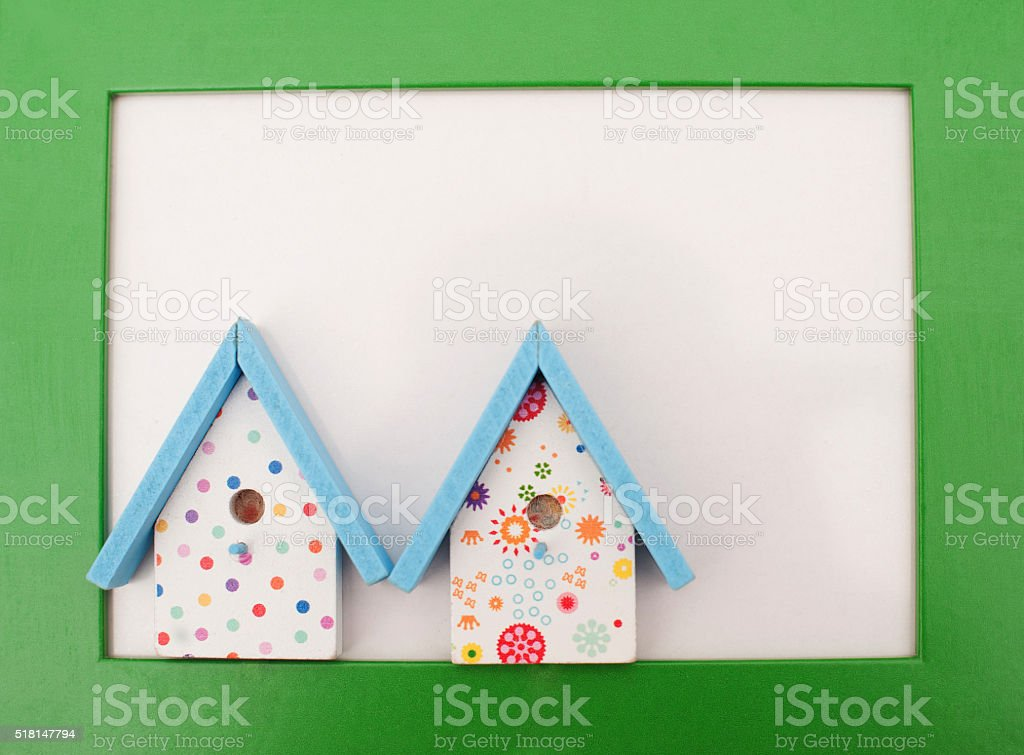 Green frame with bird houses stock photo
