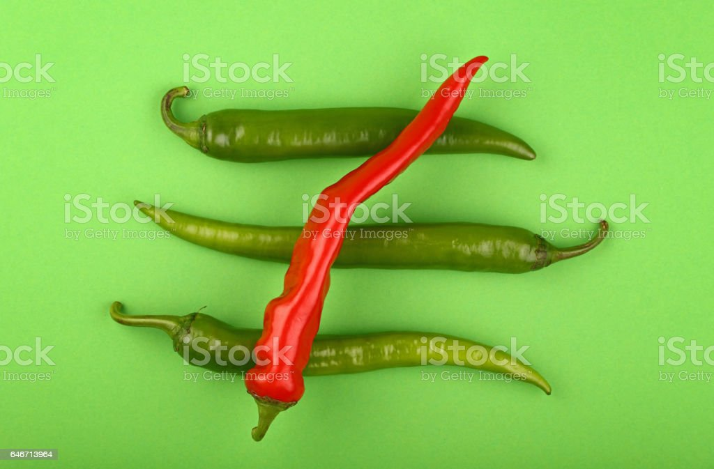 Green fresh jalapeno and red hot chili peppers stock photo