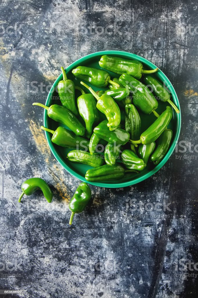 Green, fresh jalapeno peppers. Spicy Mexican food. Dark background. stock photo