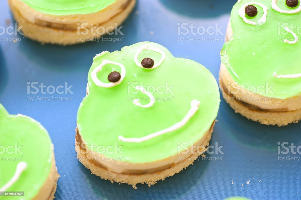 green frog cake with face stock photo