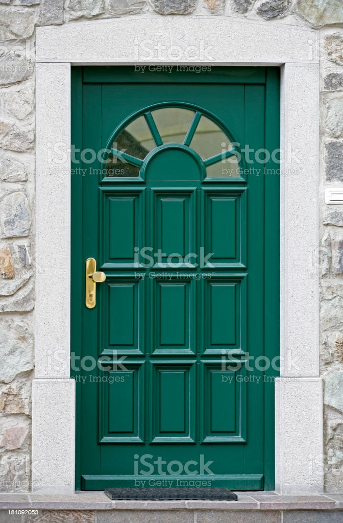 Green front door, isolated without a house royalty-free stock photo