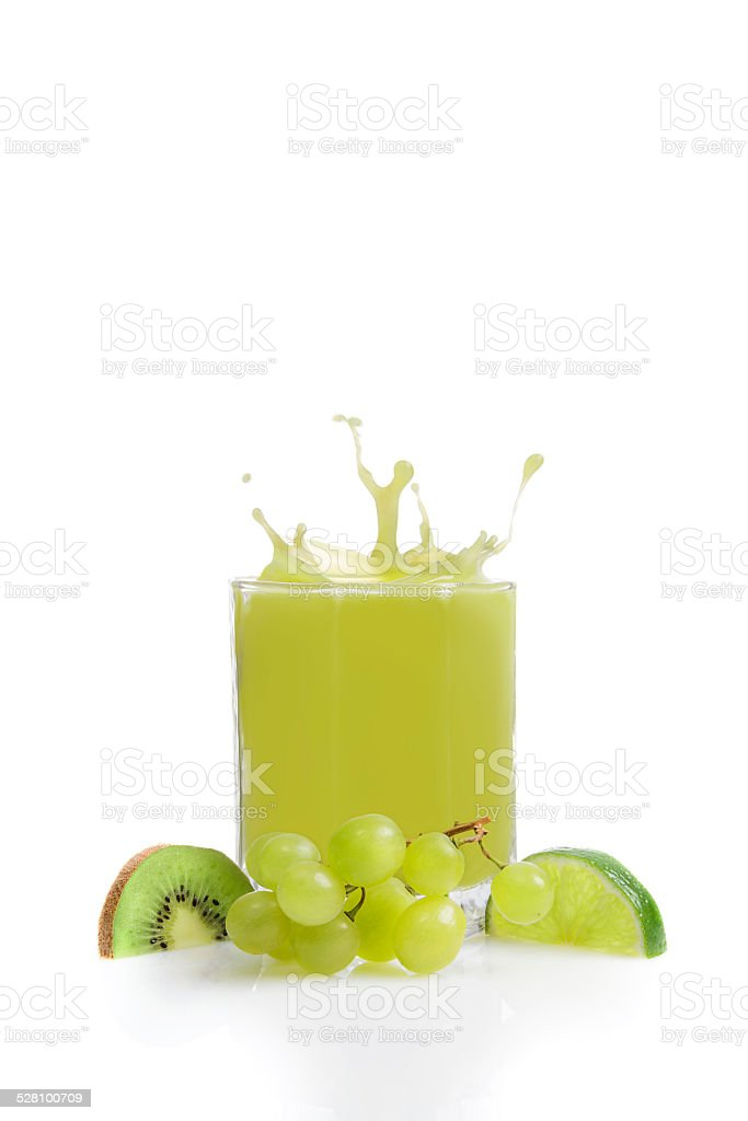 Green fruit juice from kiwis, lime and grapes stock photo