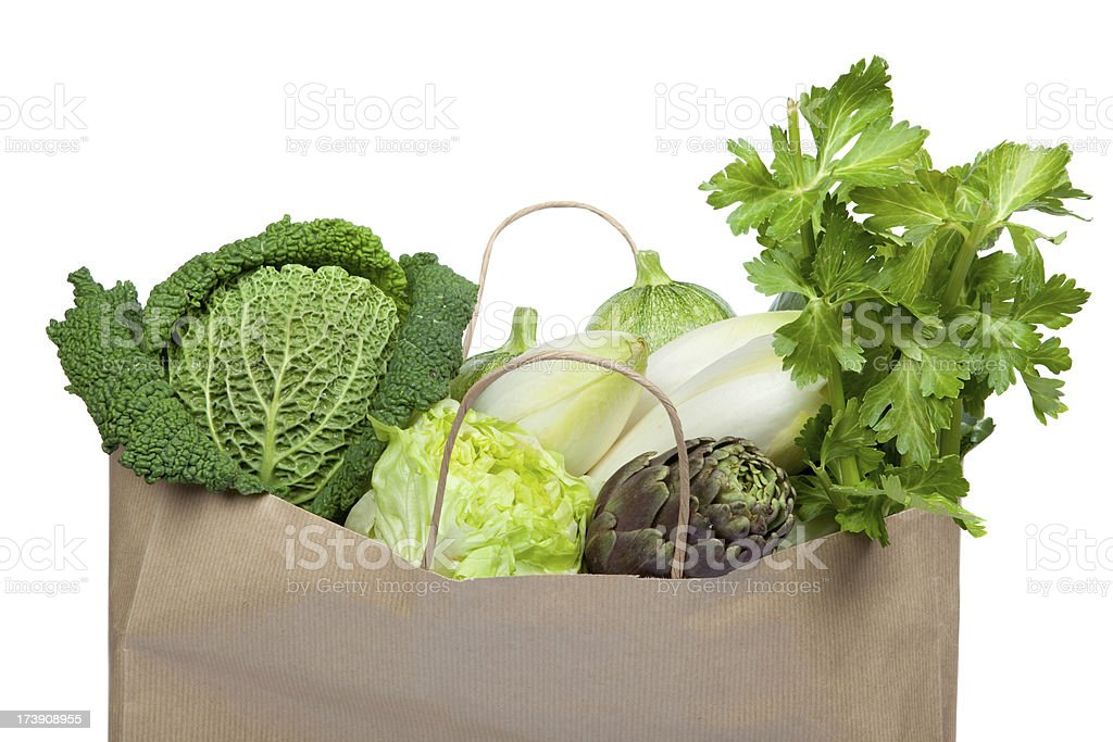 green fruit vegetable composition in paper shopping bag isolated royalty-free stock photo
