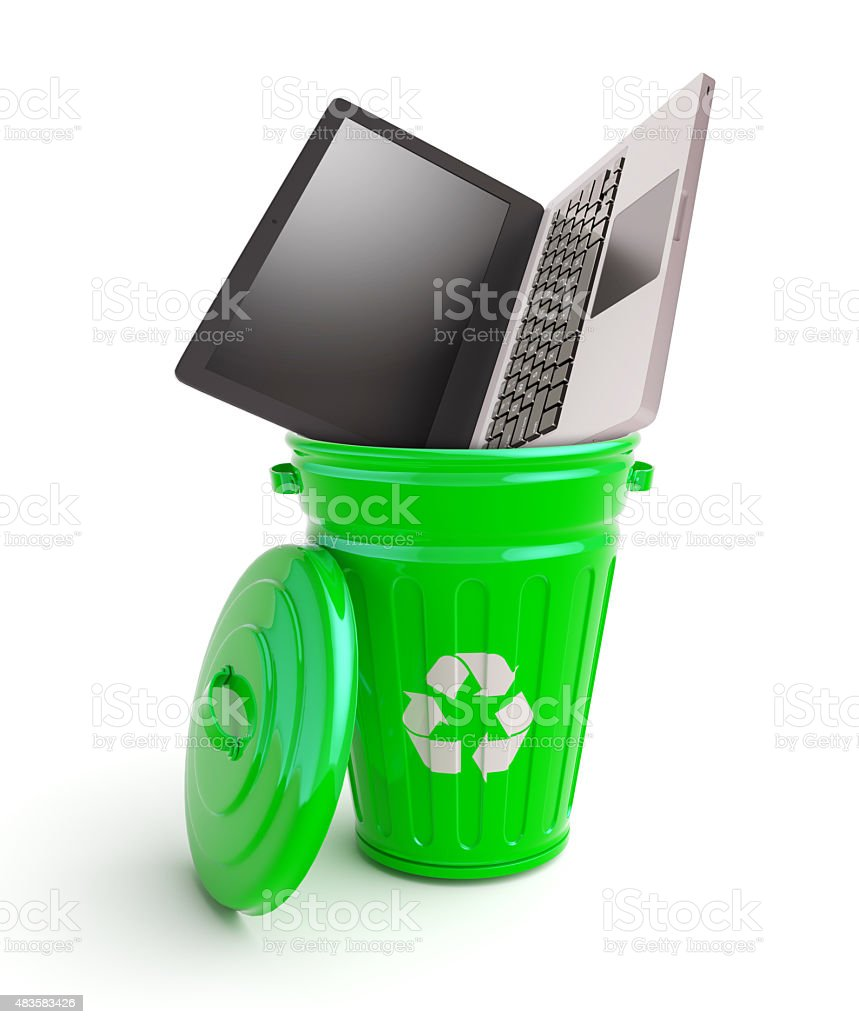 Green garbage bin with computer stock photo