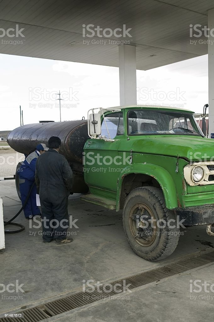 Green gasoline truck on a petrol filling station stock photo
